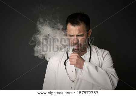 portrait of handsome doctor smoking and coughing