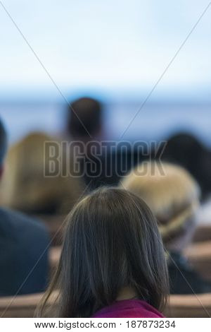 Blur of People At the Conference.Vertical Image Orientation