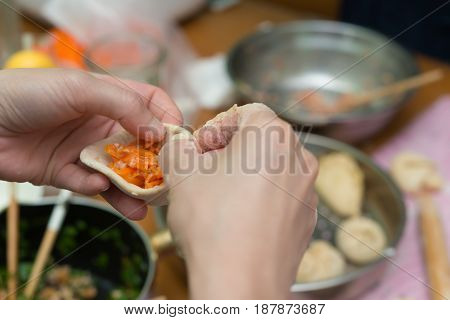 lady making traditional chinese bun at home