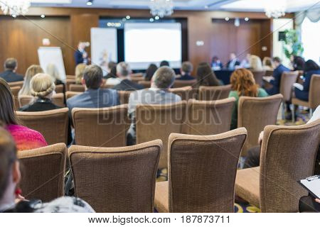 Business Conferences Concepts. People at the Law Conference Listening to The Host in Front of The Big Screen.Horizontal Image