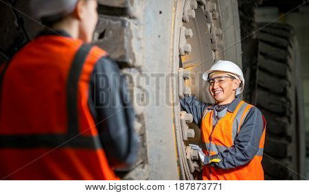 mechanic in the garage fixing big truck