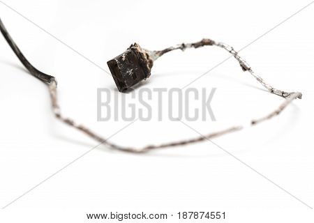 a burnt out usb cable on white