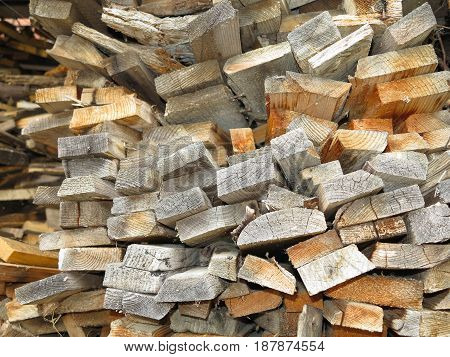 Abstract background of dry stack old plank firewood.