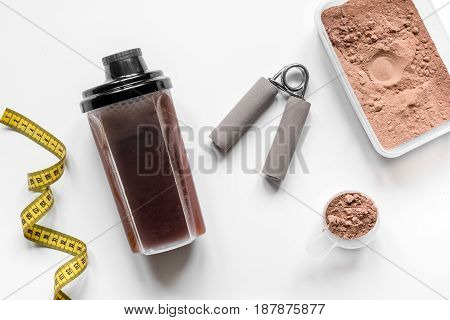 Sport and diet nutrition with equipment on white table background top view