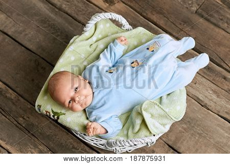 Basket with baby, top view. Little caucasian kid.