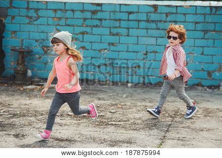 photo of two cute little running hipsters