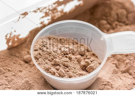 Sport and diet nutrition equipment on stone table background