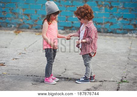 photo of two cute hipsters sharing candy