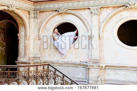Beautiful Young Bride Posing In Window.
