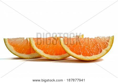 Closeup of grapefruit wedges on a white background