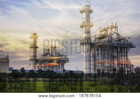 Double exposure power plant and nature of rice field white sky on sunset .