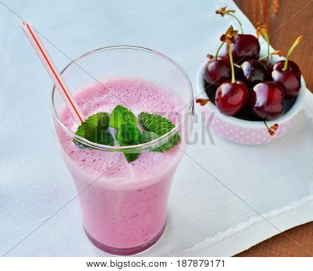 Healthy pink smoothie liquid food with cherries and Greek yogurt in glass
