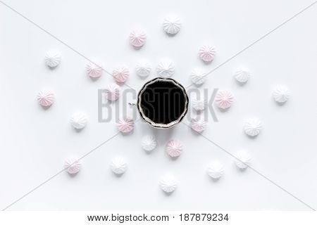 woman desk with coffee and marsh-mallow in spring breakfast desing on white background flat lay