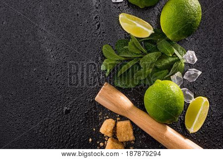 Lime Slices With Brown Sugar And Wooden Squeezer On Stone Board, Barman Cocktail Background