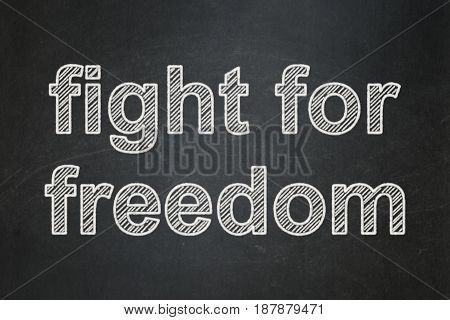 Politics concept: text Fight For Freedom on Black chalkboard background