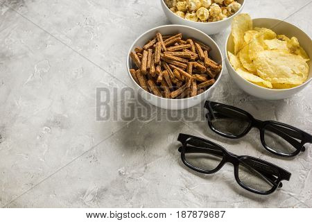 cinema and TV whatching with crumbs, chips and pop corn on stone background mock-up