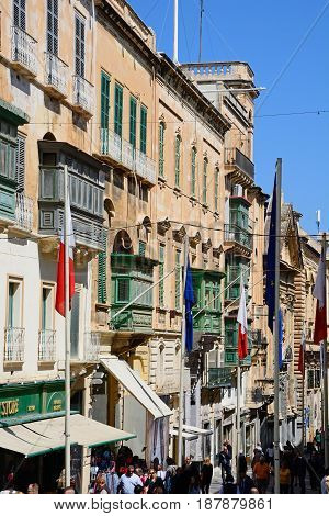 VALLETTA, MALTA - MARCH 30, 2017 - Tourists walking along Republic Street aka Triq Ir Repubblika Valletta Malta Europe, March 30, 2017.