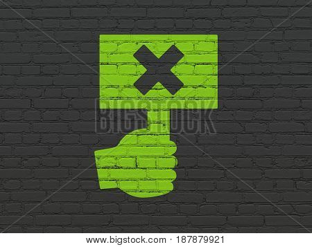 Political concept: Painted green Protest icon on Black Brick wall background