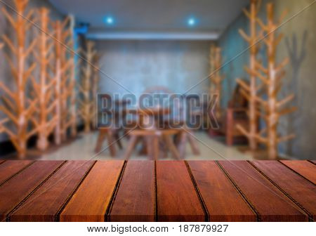 Selected focus empty brown wooden table and coffee shop cafe or restaurant blur background image. for your photomontage or product display