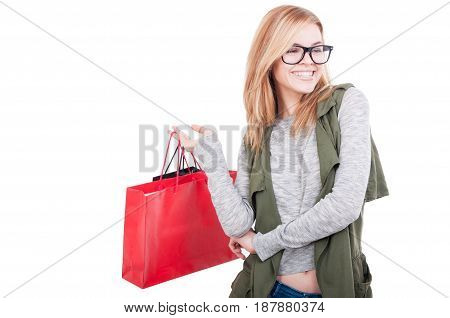 Portrait Of Young Smiling Woman With Shopping Bags