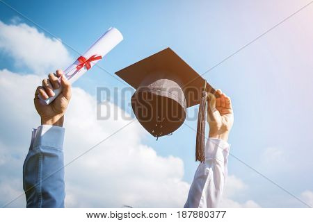 Graduation day Images of graduates are celebrating graduation put hand up a certificate and a hat in hand Happiness feeling Commencement day Congratulation