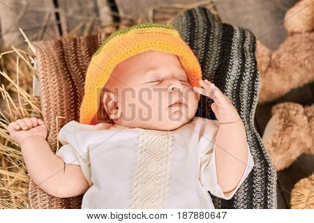 Baby is sleeping. Child in knitted hat. Fashion for babies.