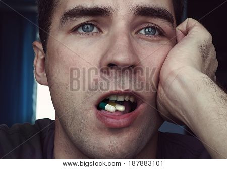 Ill Man With Open Mouth Take Pills For Throat.