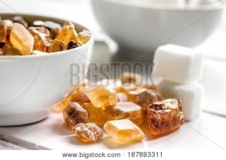 sugar cubes on kitchen white wooden table background close up