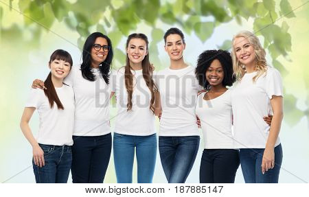 diversity, ecology and people concept - international group of happy smiling volunteer women in white blank t-shirts hugging over green natural background