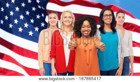 diversity and people concept - international group of happy smiling different women howing thumbs up over american flag background