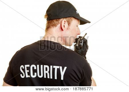 Bodyguard alarms his team with a radio during a mission