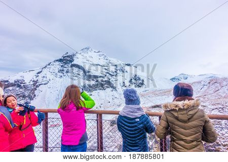 ICELAND - MARCH 15, 2017: Unidentified people at waterfall in Iceland, winter season
