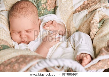 Sleeping baby close up. Caucasian infant with eyes closed.