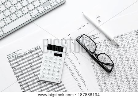 business taxes accounting in office work space on white desk background top view