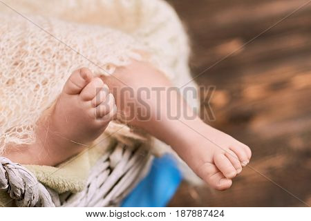 Baby feet close up. Legs of an infant. First year of life.