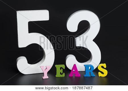 Letters And Numbers Fifty-three Years On A Black Background.