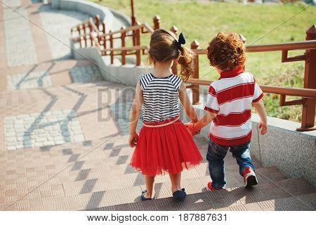 photo of cute little children on stairway