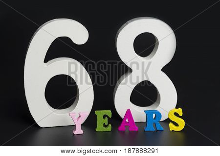 Letters And Numbers-sixty-eight On A Black Background.