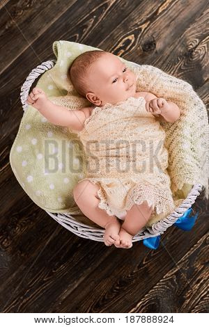 Top view of baby boy. Child wrapped in blanket, basket. New beautiful life.