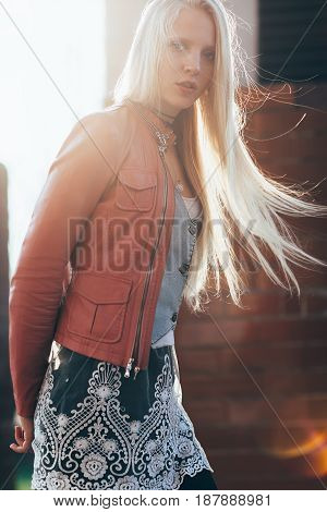 Beautiful Blond Woman With Wind In Her Hair Backlit By Sunshine