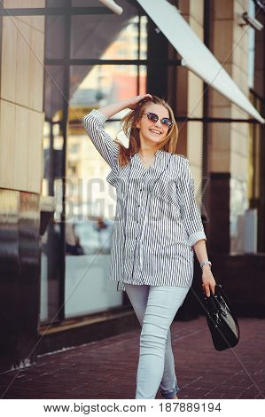 Young Happy Woman Walking Around The City