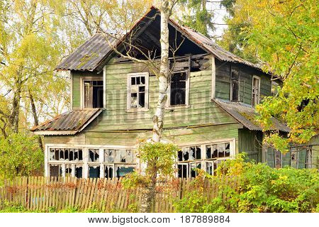 View of old abandoned rustic wooden house.