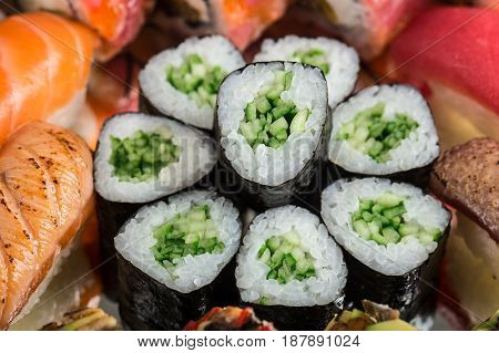 Close up of kappa maki made with rice, nori and cucumber