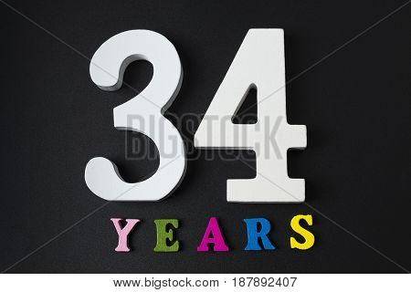 Letters And Numbers Thirty-four Years On A Black Background.
