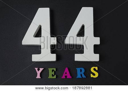 Letters And Numbers Forty-four Years On A Black Background.