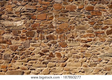 Old stone wall to use as wallpaper