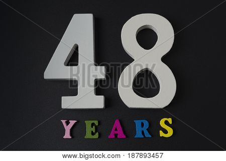 Letters And Numbers-forty-eight On A Black Background.