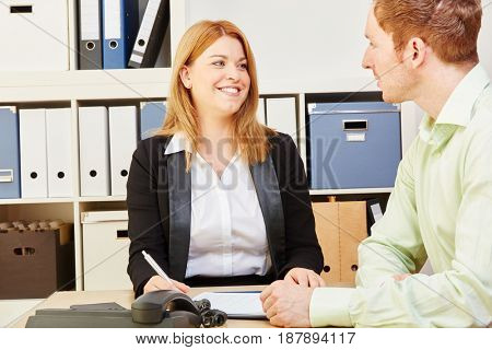 Woman giving financial advice to a man for a credit1