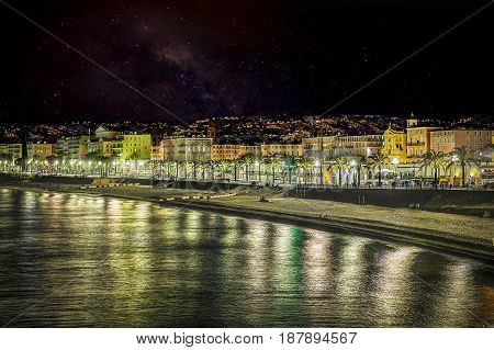 Breathtaking view of Nice Beach at the promenade in night vision.
