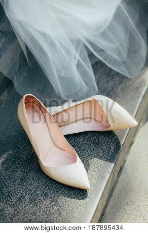 Beautiful white wedding shoes for brides close up